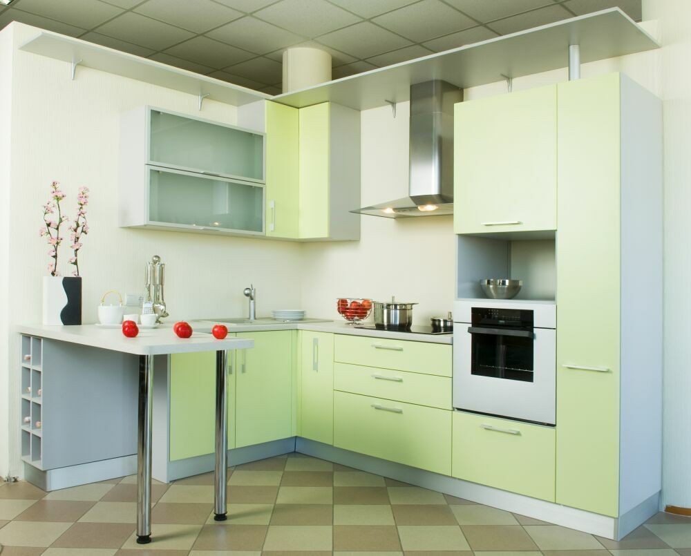 Modern Bar Counter Kitchen Design Ideas. Soothing light green surfaces of the kitchen furniture