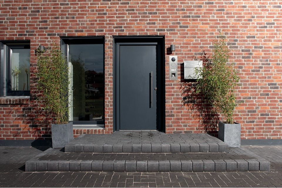 Entry to the German red brick house in formal style