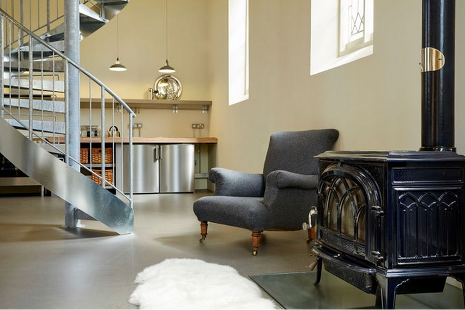 Spiral staircase private house design ideas. Chic looking armchair and vintage chamber