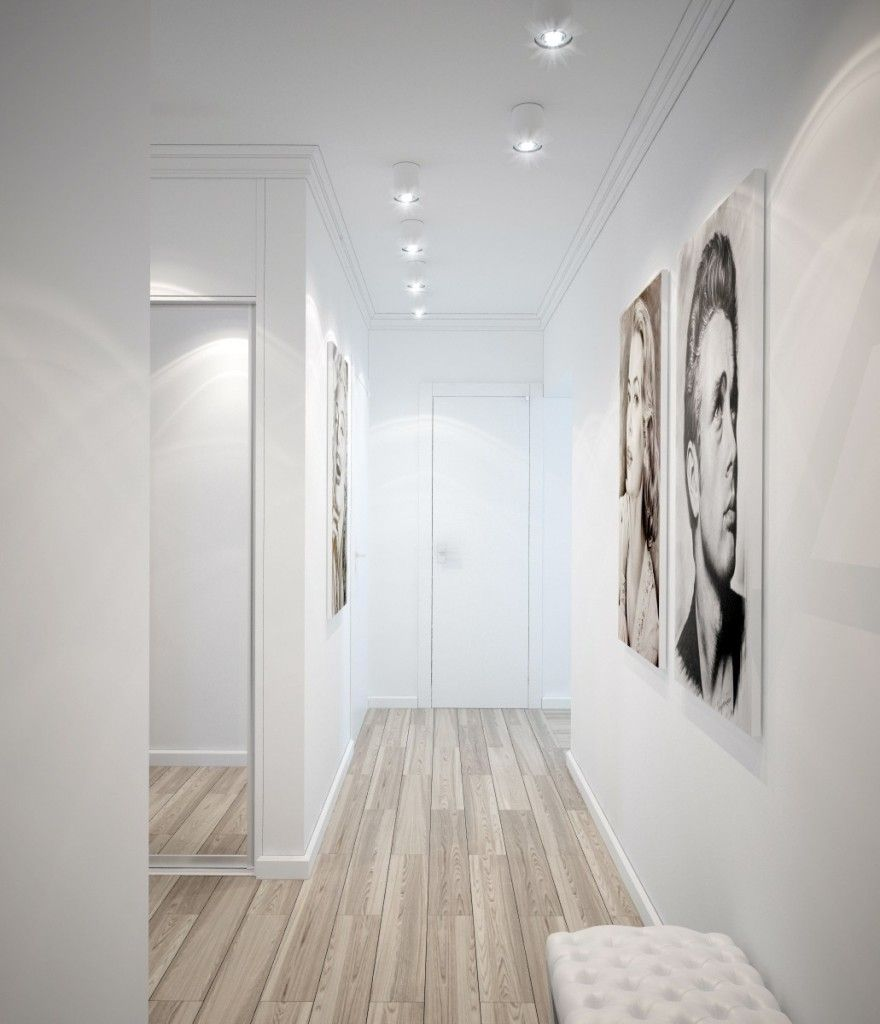 White and wooden hallway interior emphasized by two black-white pictures