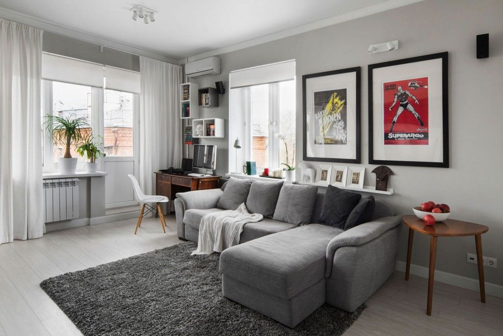 Small flat living room with all functional elements, zoning in gray tones
