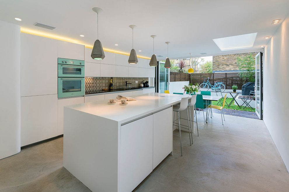 White Kitchen Interior Design Ideas with unique contrasting backsplash