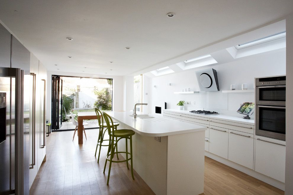 White Kitchen Interior Design Ideas in spacious private house with wooden flooring