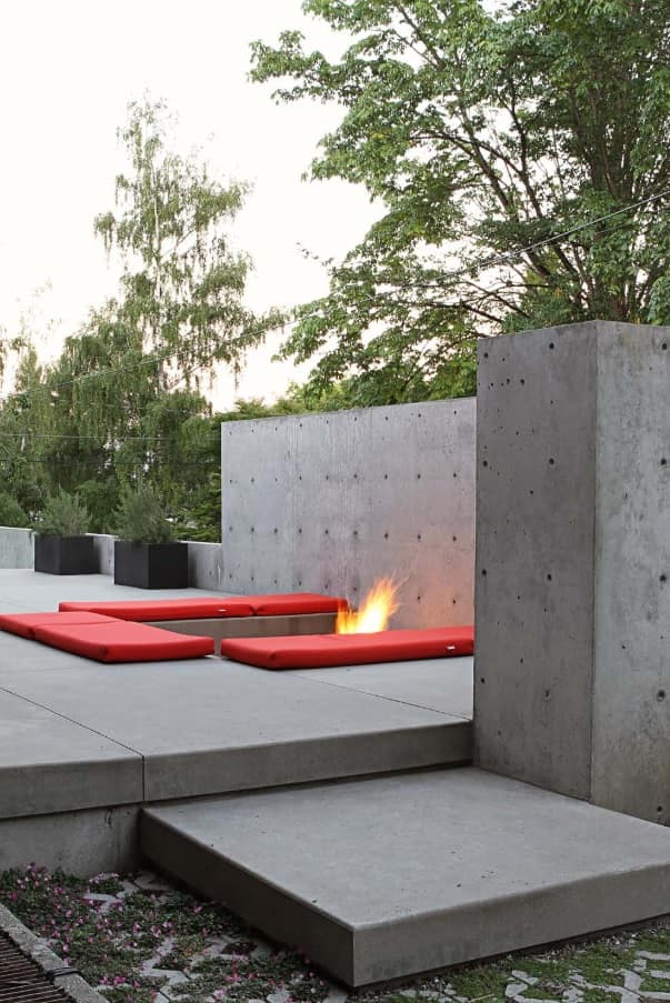 Minimalist urbanistic lounge zone made of poured concrete blocks and plates