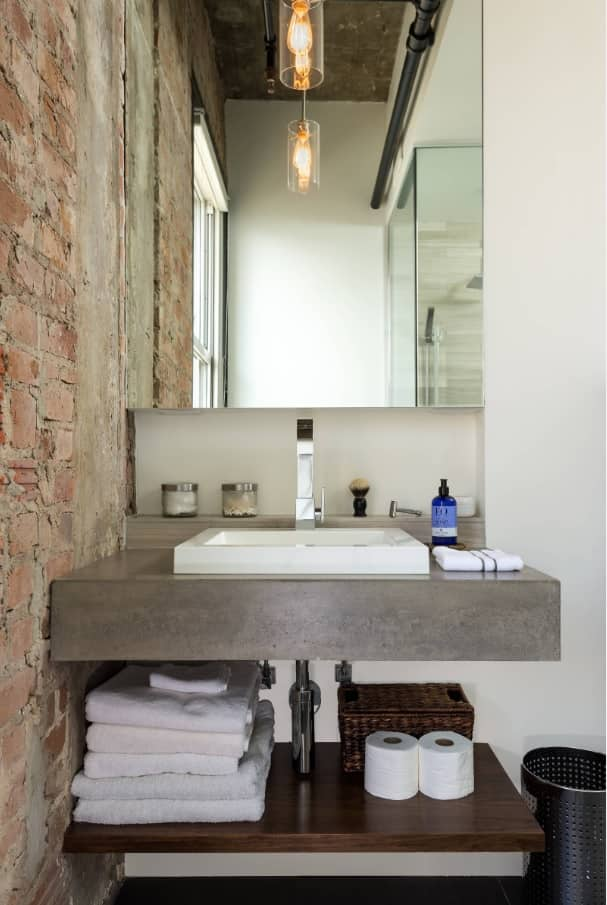 Unusual loft bathroom with concrete vanity