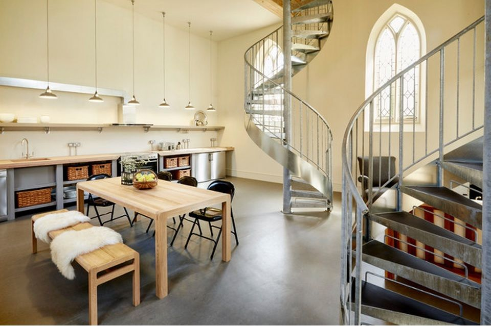 Spiral staircase private house design ideas. Staircase leading to the upper bedroom from the kitchen zone