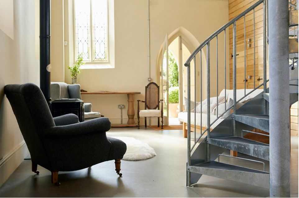 Spiral staircase private house design ideas. Perspective look through the hallway of the English private house with staircases