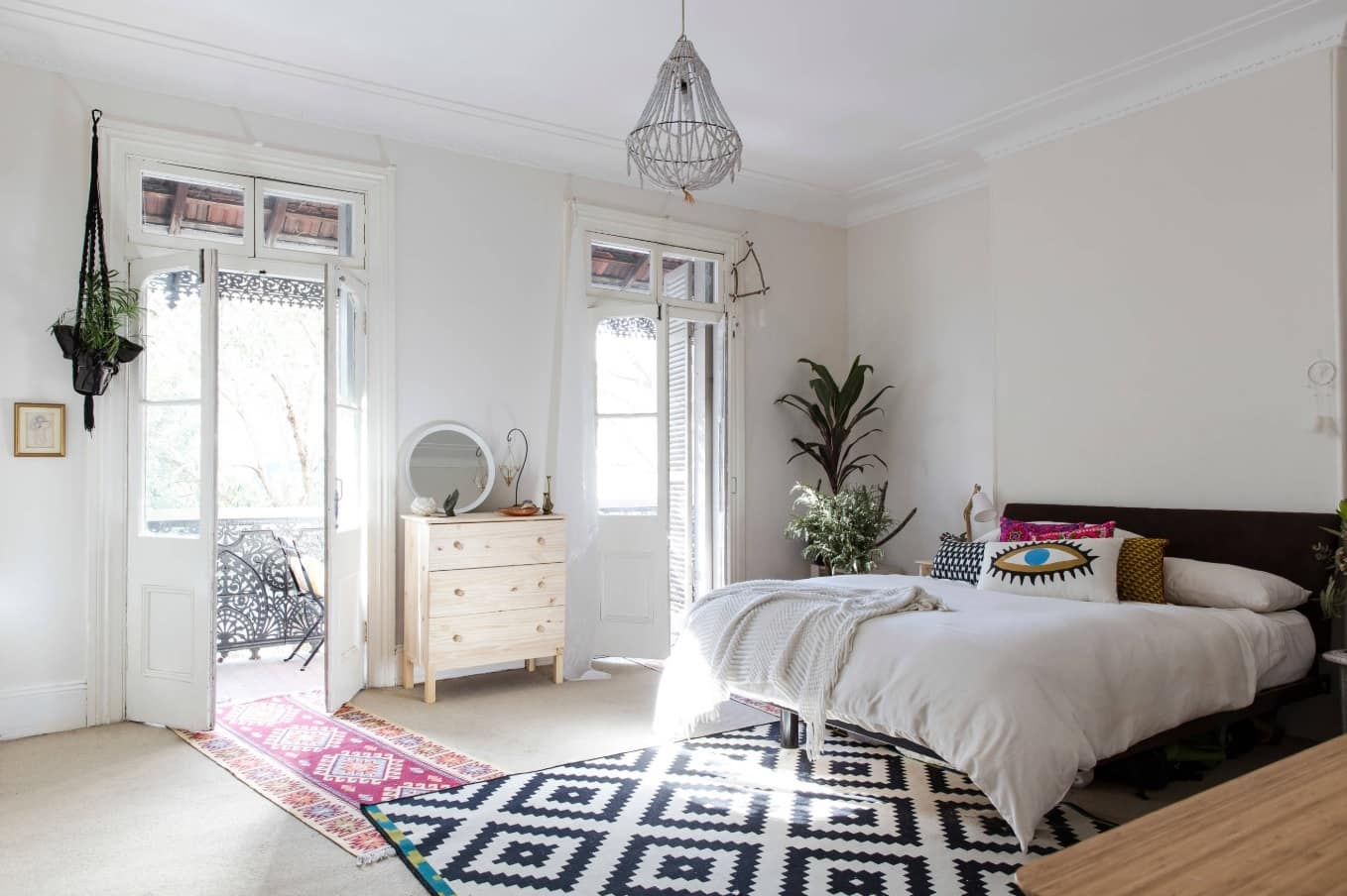 Light color scheme for modern women's bedroom with black and white carpet
