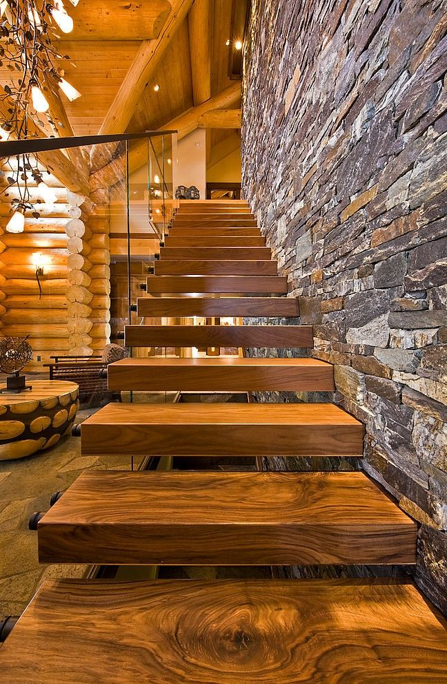 Modern Interior Staircase Materials Photo of the airy wooden stairs without any risers mounted to the wall