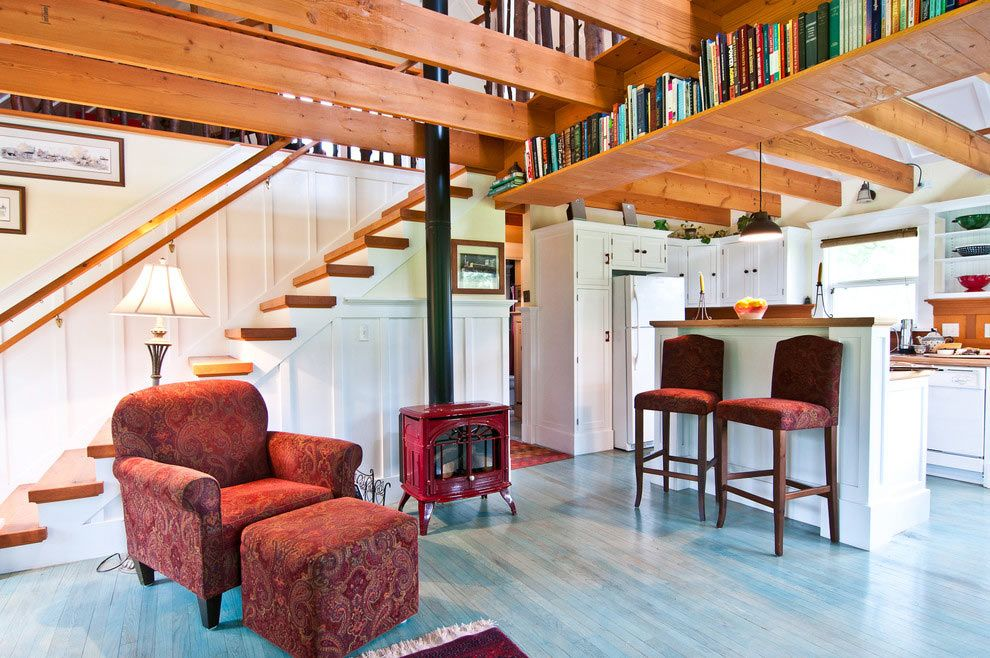 Nice Unusual Bookshelves Interior Decoration. wooden ceiling beams and staircase along with book shelving