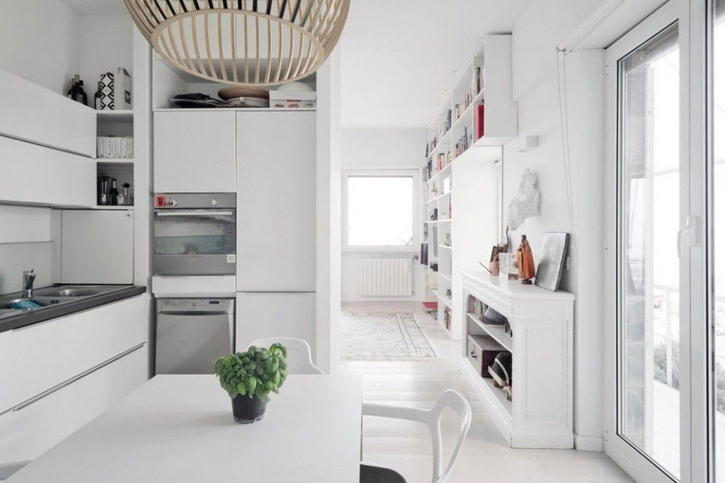 Italian Oceanside House White Modern Interior Design. Nright hi-tech design with glossy surfaces in the kitchen