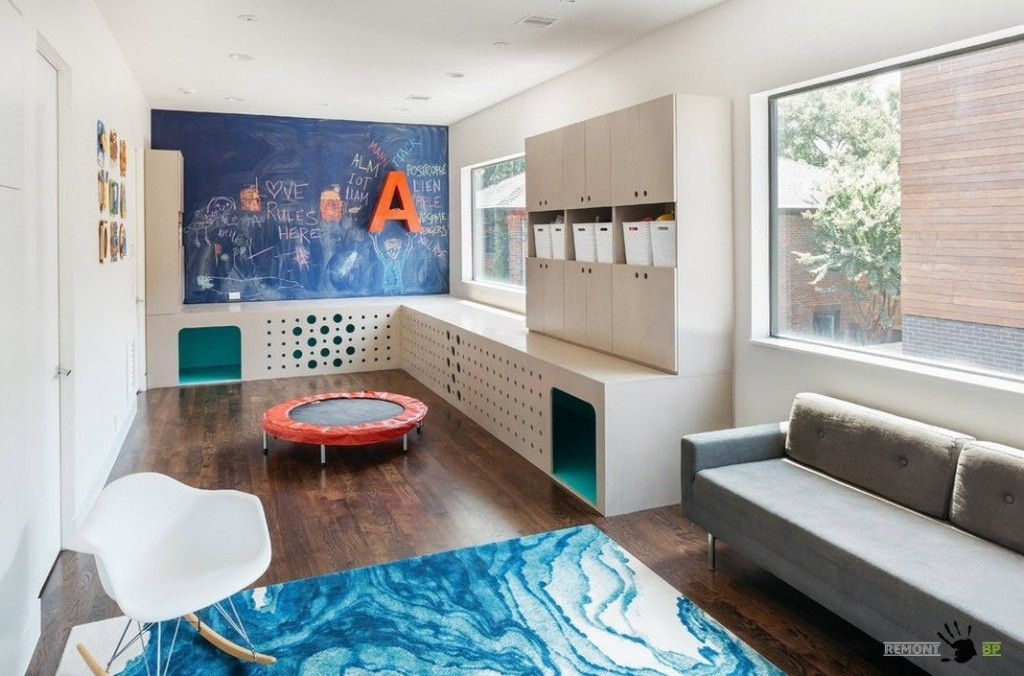 Kids` Room Furniture Selection Advice. Storage and cabinets in the large kids room with trampoline