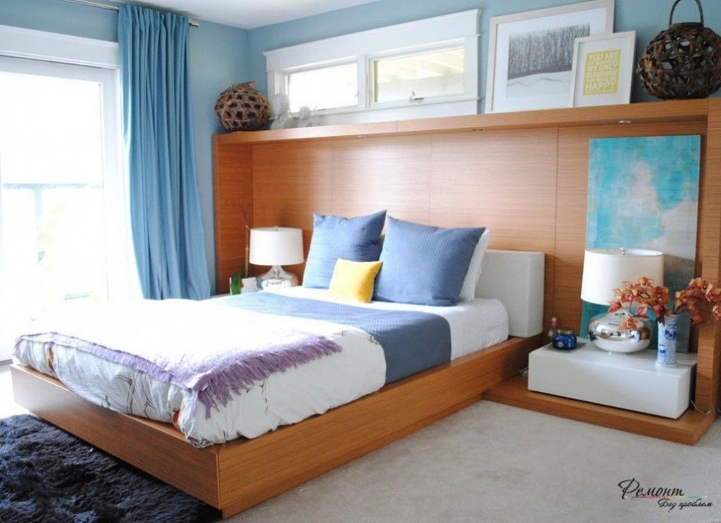 Headboard Wall Picture Placement Advice in Bedroom Interior. wooden furnishings of the bluish ambience