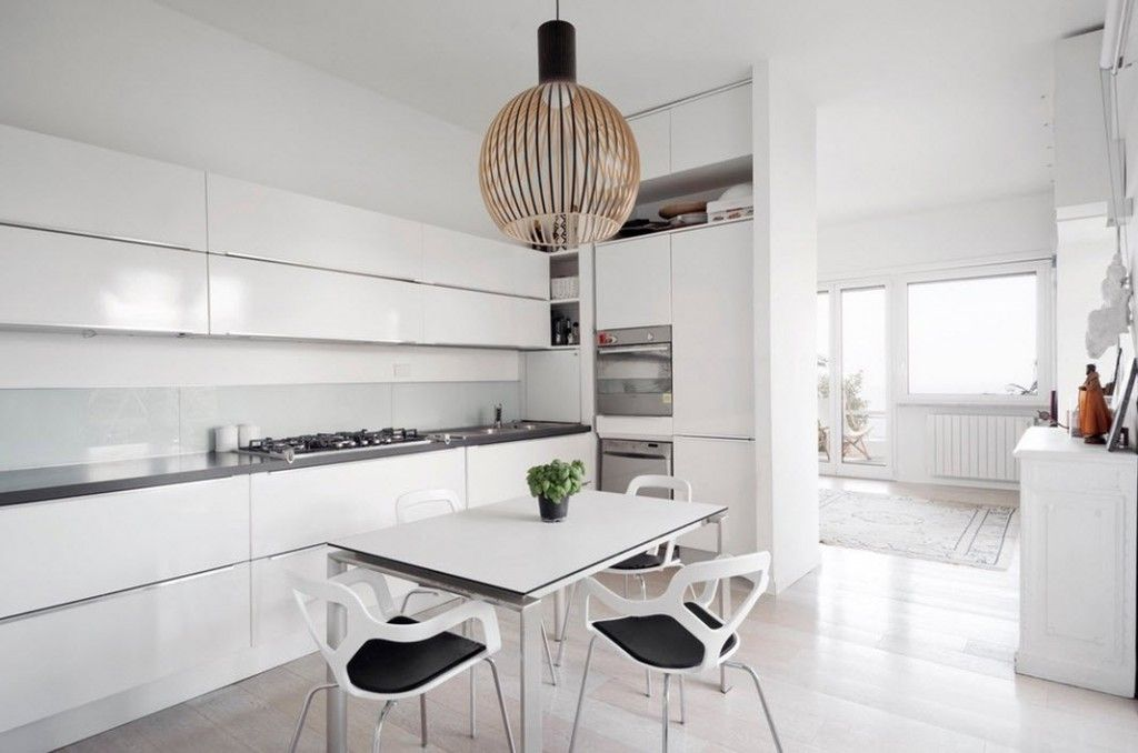 Italian Oceanside House White Modern Interior Design. Absolutely snowy interior with one bright lamp contrast