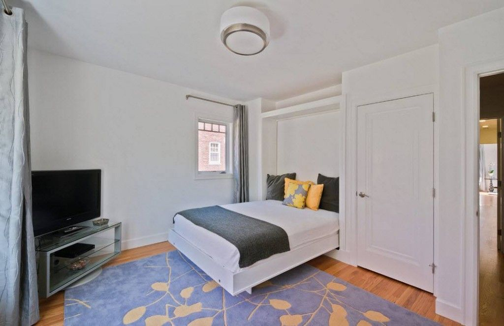 Built-in Bed Small Apartments Interior Design Solution. Brickwork White finishing and low-key furnishings in the small flat