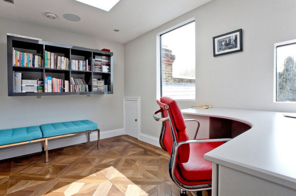 London Bunk Apartment Modern Interior Design Ideas. Window without sill and small turquoise ottoman for rest in the small home office