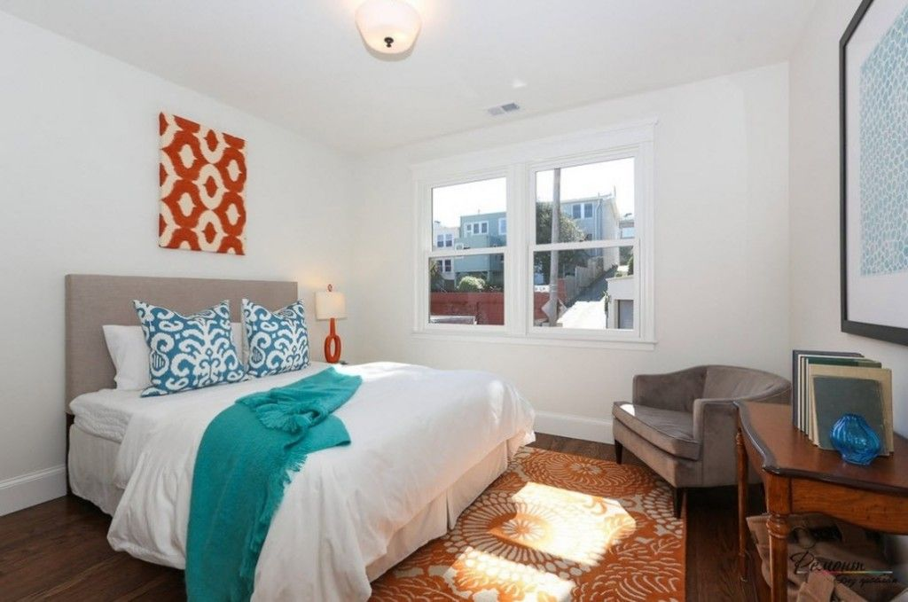 Headboard Wall Picture Placement Advice in Bedroom Interior. white finish with contrasting turquoise elements