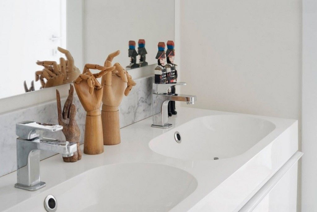 Italian Oceanside House White Modern Interior Design. Double sink and wooden artificial wrists as a decoration