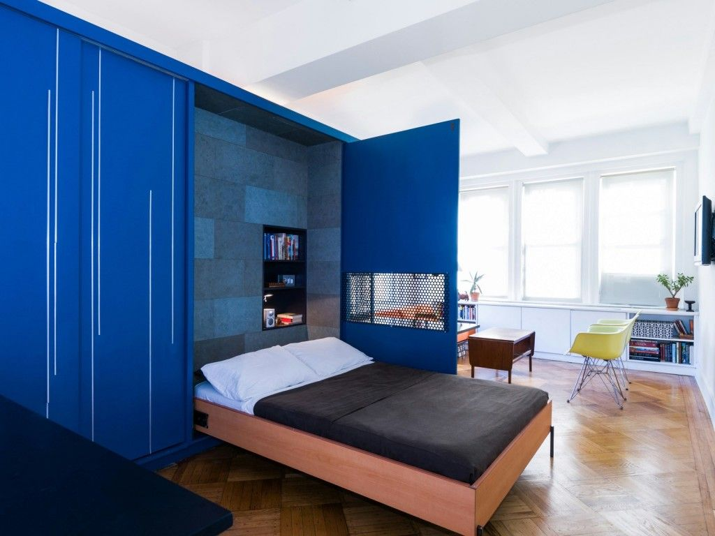 Built-in Bed Small Apartments Interior Design Solution. Brickwork. Blue cabinet hides double