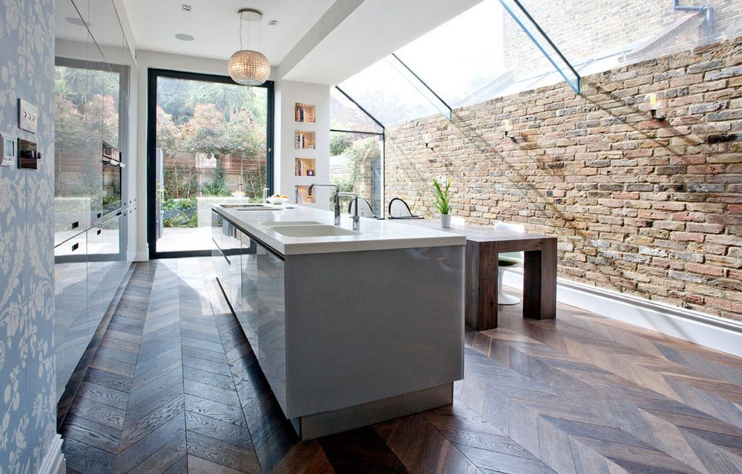 large kitchen island has undergone not only the integration of storage and work surfaces but also two sinks and hob freeing single row layout of the     london bunk apartment modern interior design ideas  rh   smalldesignideas com