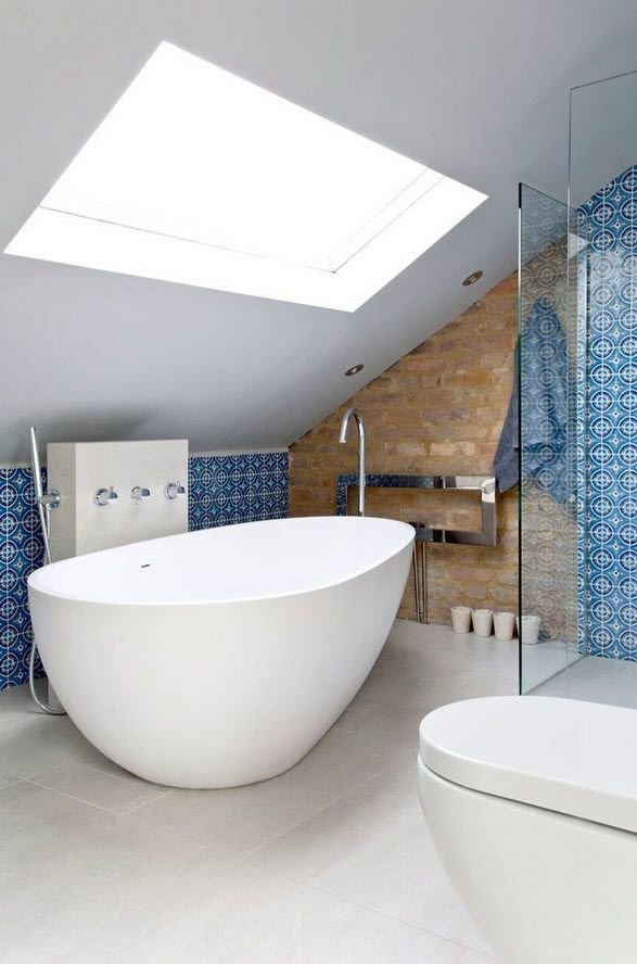London Bunk Apartment Modern Interior Design Ideas oval form of the bathtub repeating the form if sinks under the sloped attic with skylight looks very trendy