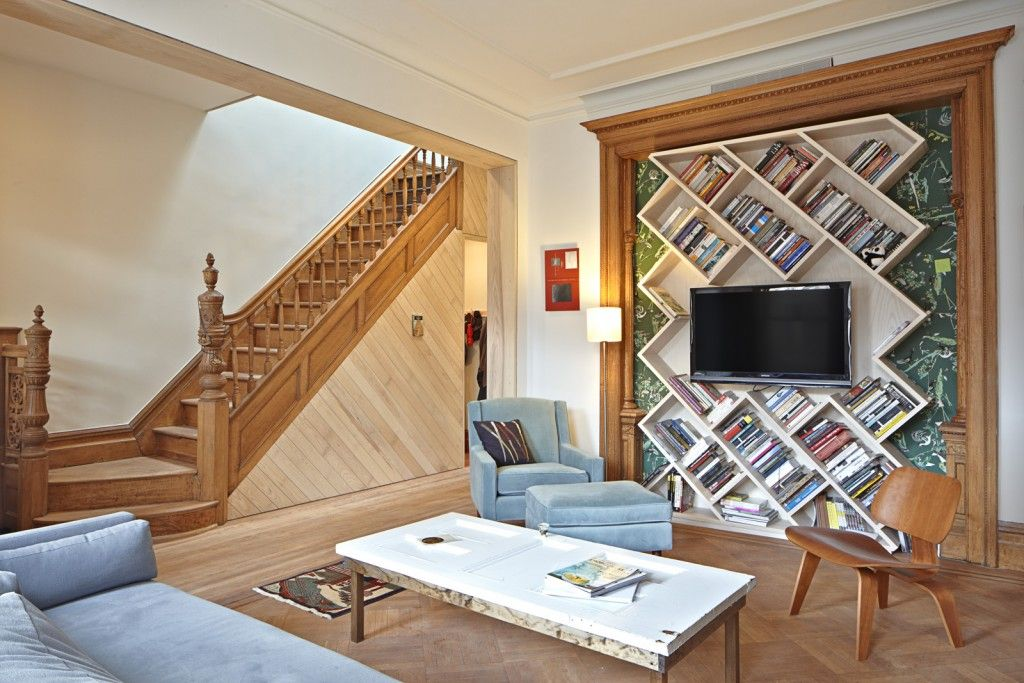 Nice Unusual Bookshelves Interior Decoration. Sloped rombic shelves behind the TV area