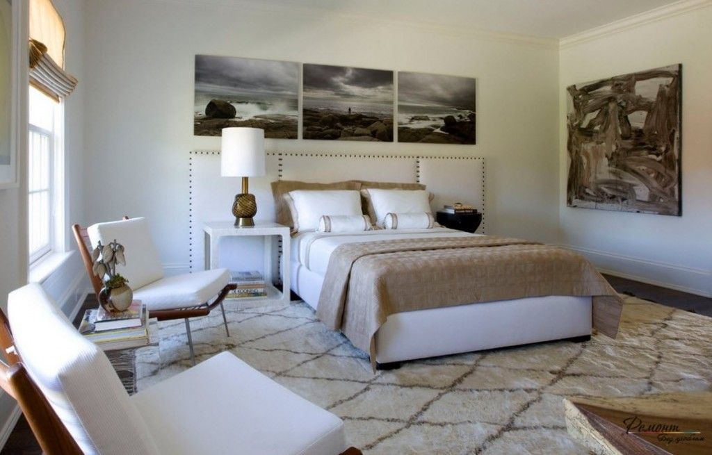 Headboard Wall Picture Placement Advice in Bedroom Interior. Naturalistic paintings in the ambience full of fabric