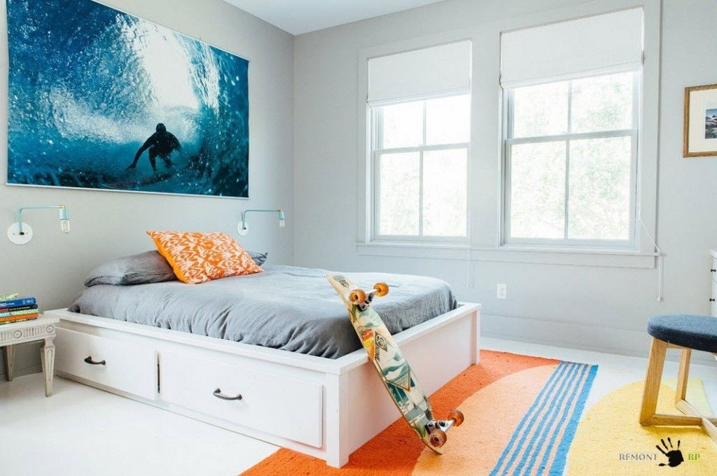 Kids` Room Furniture Selection Advice. Boy`s room with skate and dynamic picture on the white wall