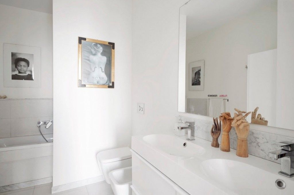 Italian Oceanside House White Modern Interior Design. Experimental and even weird decoration in the bathroom