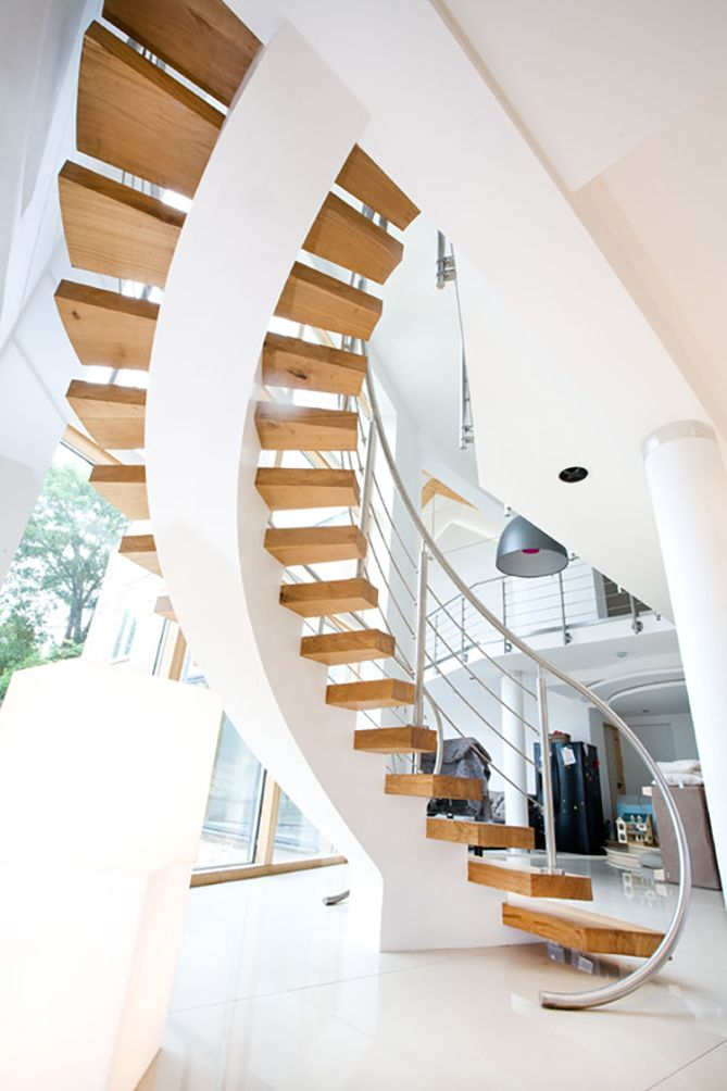 Interior Staircase Original Design Ideas. Bewutching white curved construction with central rail as the foundation