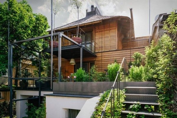 Romanian Private House Green Eco Design. Unusual oriental looking wooden hut in a fog