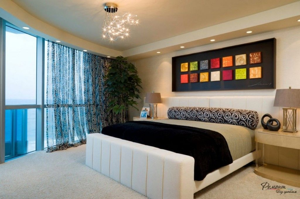 Headboard Wall Picture Placement Advice in Bedroom Interior. Dark notes in the modern atmosphere and matrix of small bright paintings
