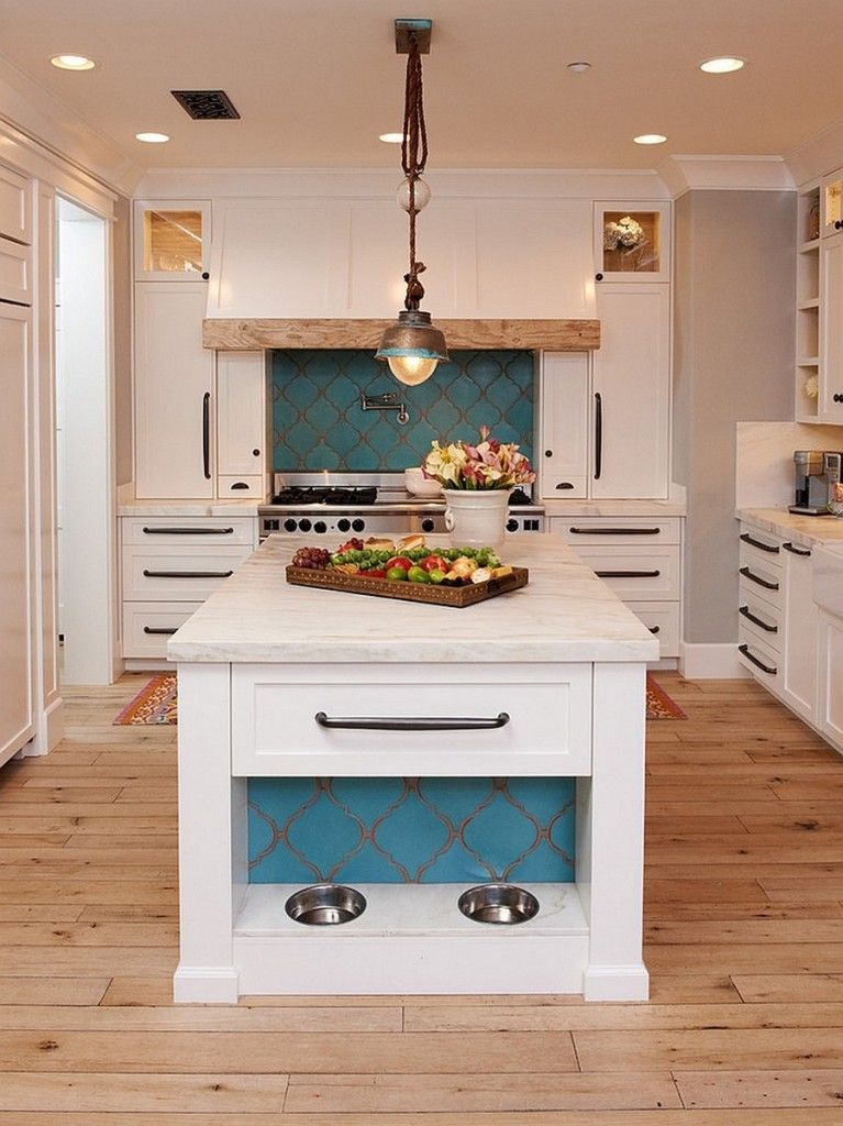 Mediterranean Interior Design Style. White neat outsdanding example of kitchen with the criss-cross facade decoration at the blue backdrop