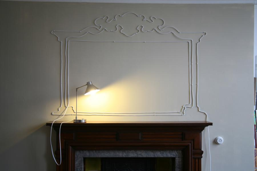 Wires and Cords as Interior Decorating Ideas imitating fireplace on the empty wall