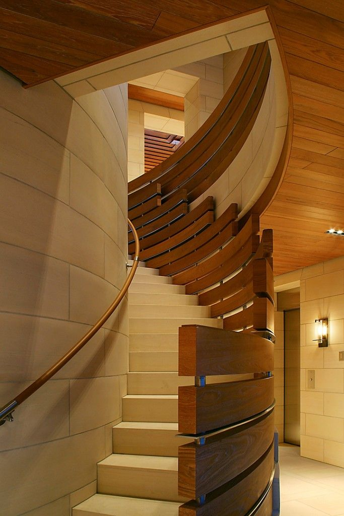Staircase Modern Constructions Types Design. Nice curved stairs with original wooden handrails provides high level of safety