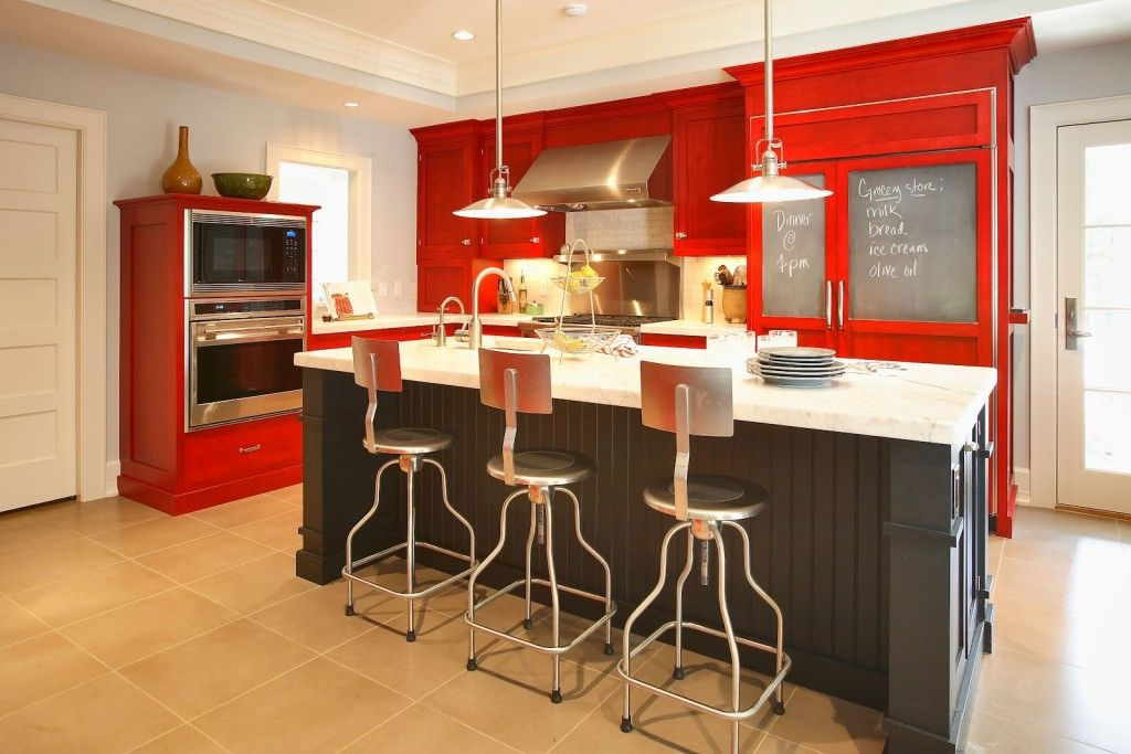 Red Color Interior Design Ideas. High bar stools and red surfaces of the kitchen set makes the interior fresh and lushy