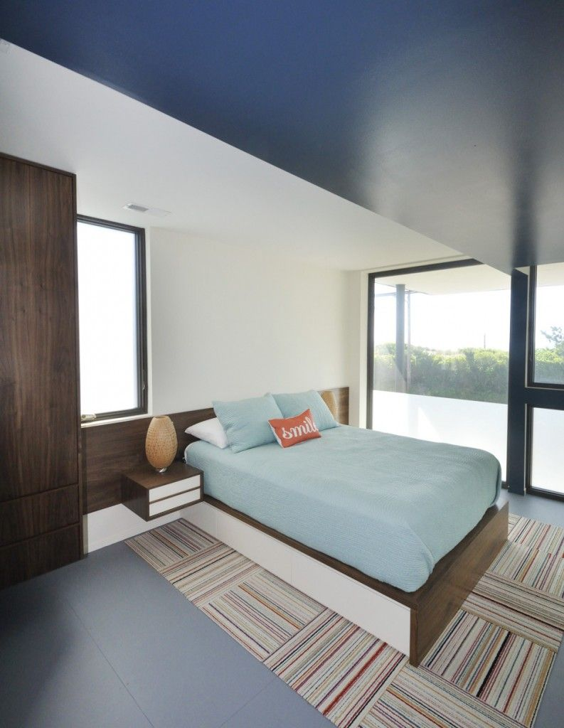 Rugs, Carpet, Carpeting Interior Design Ideas in the seaside house with sloped painted blue ceiling at the loft