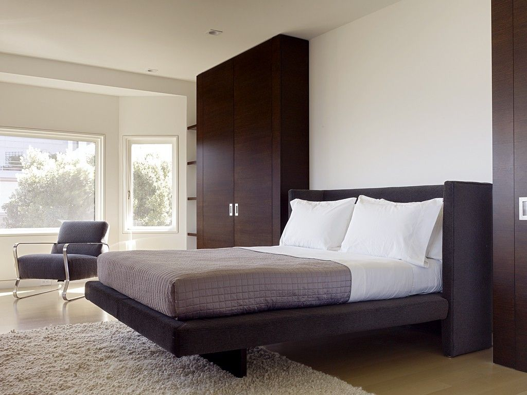 Bedroom Interior Furniture Set Programme Ideas. Black high wooden cabinet in the predominantly white bedroom interior