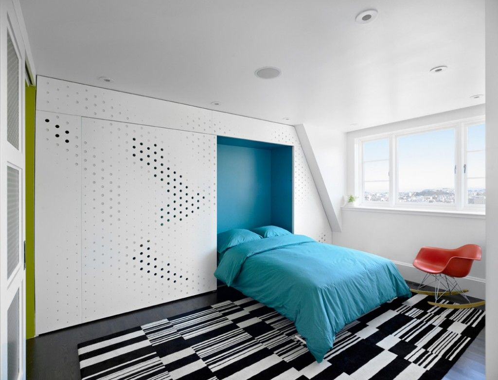 Built-in Bed Small Apartments Interior Design Solution for the bright condo with perforated cabinet doors and turquoise bed linen accents