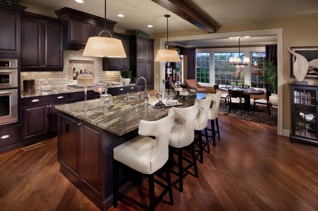 Mediterranean Interior Design Style. Dark kitchen design with broad dining  zone