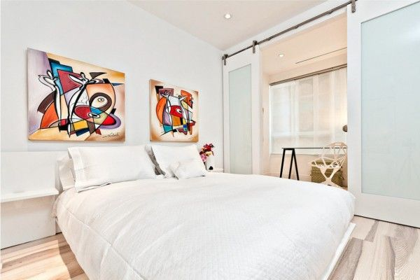 Headboard Wall Bedroom Interior Picture Placement Advice. Totally white ambience with contrasting pair of pictures