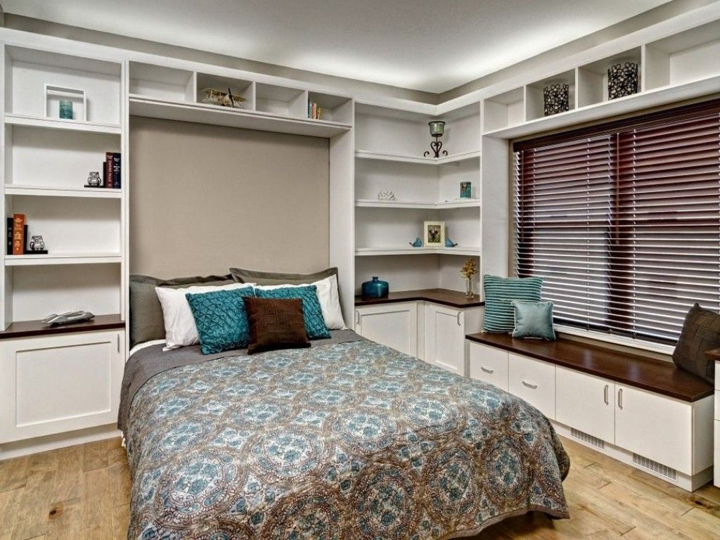 Built-in Bed Small Apartments Interior Design Solution. Lots of shelves in multifunctional room