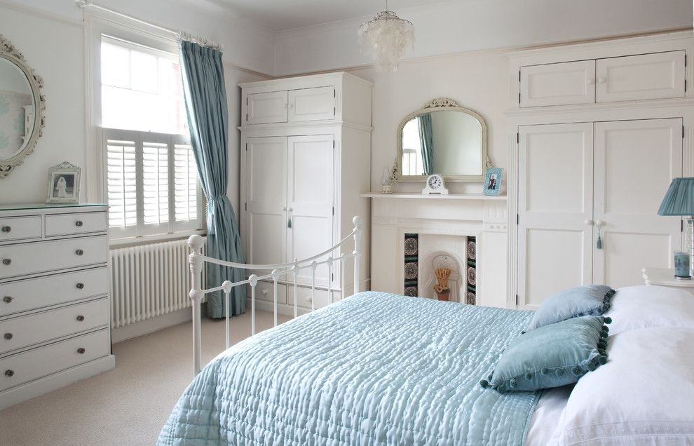 Bedroom Interior Furniture Set Programme Ideas. Light blue textile bed cover in the classic room interior