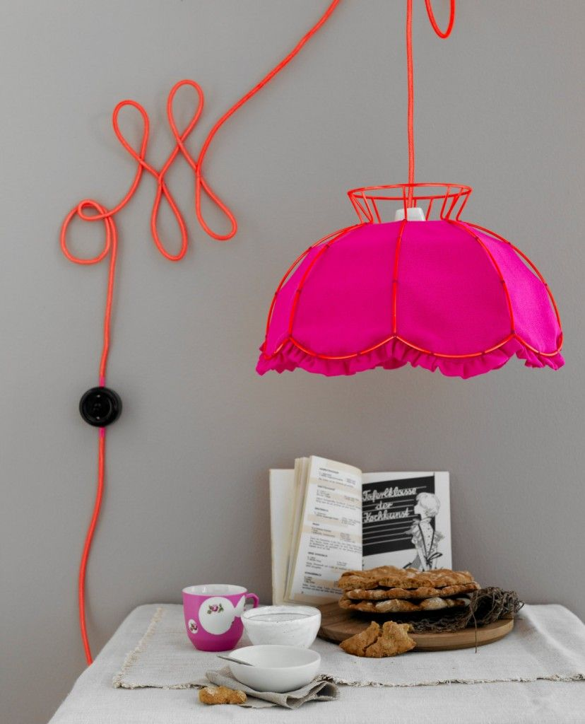 Wires and Cords as Interior Decorating Ideas for the lamp with pink shade in the reading zone