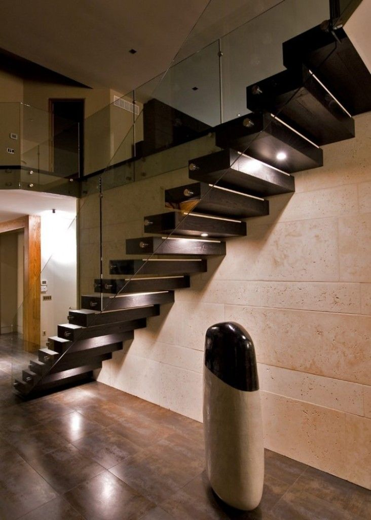 Staircase Modern Constructions Types Design. Lamost lofty construction built in the wall and based on rail stringer with glass handrails
