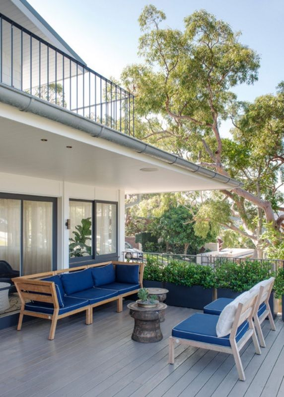 Australian Ocean Shore Private House Design Review. Backyard veranda with bright blue upholstered furniture at athe open air for chatting and croud rest