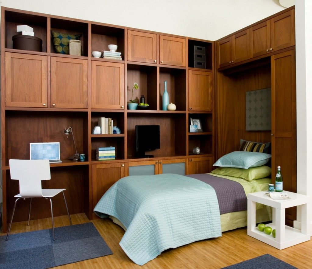 Built-in Bed Small Apartments Interior Design Solution. Business furniture and hidden white sleeping place