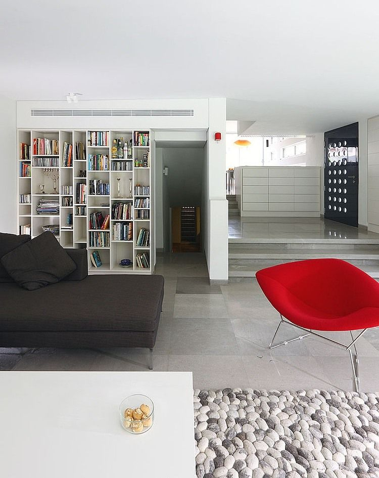 Nice Unusual Bookshelves Interior Decoratio. Spacious living eoom accomodates bed, red armchair and library