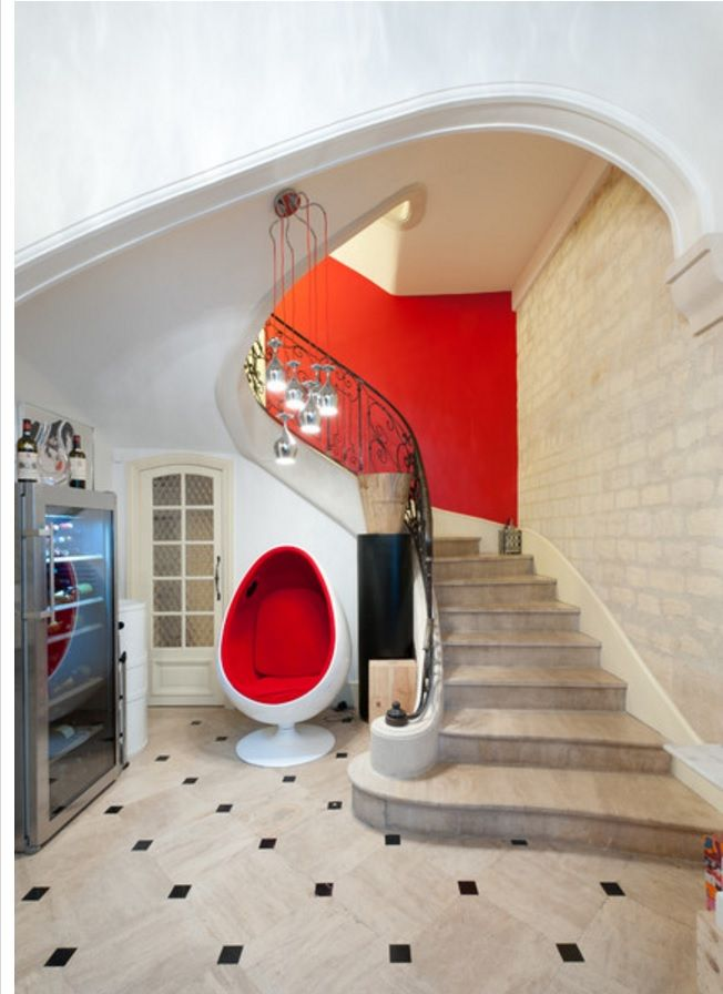 Modern Interior Staircase Materials Photo. Red egg armchair near the elegant stone staircase