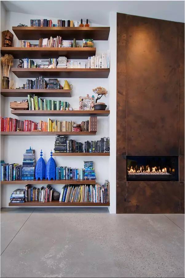 Nice Unusual Bookshelves Interior Decoration. wall with firplace contrasts with book wall